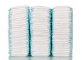 Three stacks disposable diapers isolated on white. Royalty Free Stock Photo