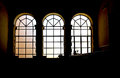 Three stained glass windows in backlight a view of high contrast background landscape cut Royalty Free Stock Photos