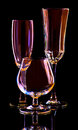 Three stemmed drinking glasses on black brandy snifter champagne flute and cordial glass Royalty Free Stock Image