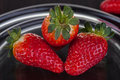 Three strawberries Royalty Free Stock Images