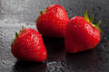 Three strawberries on black Royalty Free Stock Photo