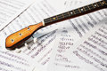 Three string balalaika fingerboard on the note background Stock Images