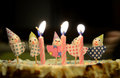 Three striped birthday candles burning top child s cake clown decorations Royalty Free Stock Photography