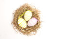 Three striped easter eggs straw white background Stock Image