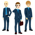 Three successful businessmen wearing blue suits standing in different poses Stock Photos