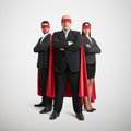 Three superheroes in formal wear Royalty Free Stock Photo