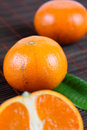 Three tangerines on a bamboo napkin Stock Photos