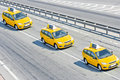 Three taxis on motorway Stock Images