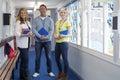 Three Teachers in School Corridor Royalty Free Stock Photo