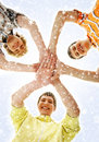 Three teenage boys holding in a form of a star happy caucasian teen modern clothes together the image is taken on blue snowy Stock Image