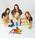 Three teenage cooks Royalty Free Stock Photo