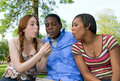 Three Teenage Friends Blowing on Dandelion Royalty Free Stock Image