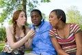Three Teenage Friends Blowing on Dandelion Royalty Free Stock Image