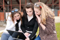 Three teenage girls with laptop Stock Photography