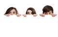 Three teenagers peeking over a white background Stock Photos