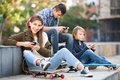 Three teenagers with smartphones Royalty Free Stock Photo
