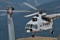 Three thumping assemblers under the helicopter