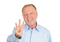 Three times closeup portrait of senior mature man giving a fingers sign gesture with hands isolated on white background positive Royalty Free Stock Photography
