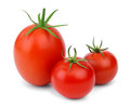 Three tomatoes ripe red of different sizes and shapes isolated on white background Stock Image