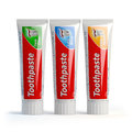 Three toothpaste containers on white isolated background.