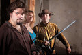 Three tough sword fighters in a dungeon Royalty Free Stock Image