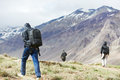 Three tourist hiking in india mountains traveller hiker walking himalayas Stock Image