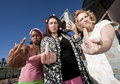 Three Trashy Women making a Rude Gesture Stock Photos