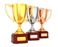 Three trophy cups in a row Royalty Free Stock Photo