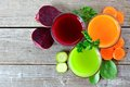 Three types of healthy vegetable juice above view on wood Royalty Free Stock Photo