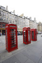 Three typical english phone boxes in a row Stock Images