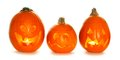 Three unique Halloween Jack o Lanterns isolated on white Royalty Free Stock Photo