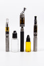 Three vape e cig and three vape juice bottles accesories all logo text removed Stock Photo