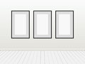 Three Vector Empty Blank White Mock Up Posters Pictures Black Frames on a Wall. Royalty Free Stock Photo