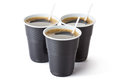 Three vending coffee cups standing white Stock Photo