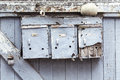 Three very old and grungy mailboxes Royalty Free Stock Photo