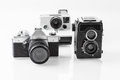 Three vintage analogue cameras on a white background Stock Images