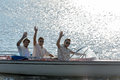 Three waving young men silhouette driving powerboat Royalty Free Stock Images