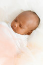 Three weeks old baby sleeping on white blanket cute infant newborn lying down close up shot eyes closed Royalty Free Stock Photo