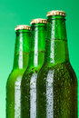 Three wet blank beer bottles Royalty Free Stock Photo