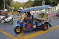 Three Wheeled Tuk Tuk Taxi in Bangkok Stock Photos