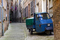 Three Wheeler in an alley in central Italy Royalty Free Stock Photo