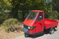 Three wheeler red pickup car Stock Image