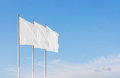 Three white blank corporate flags waving in the wind Royalty Free Stock Photo