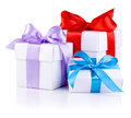 Three White boxs with Red, Purple and Blue ribbon Stock Images