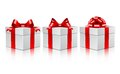 Three white gift boxes with a red bows. Stock Photo
