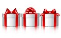 Three white gift boxes with a red bows. Royalty Free Stock Photo