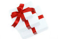 Three white gift boxes with red ribbon Stock Images