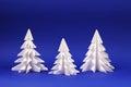Three White Paper Trees On Blu...