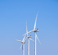 Three Wind Turbines, Against a Blue Sky Royalty Free Stock Photo
