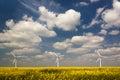 Three Wind Turbines Under A Bl...